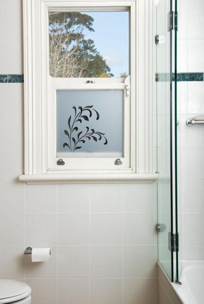 Bathroom window with decorative window film applied