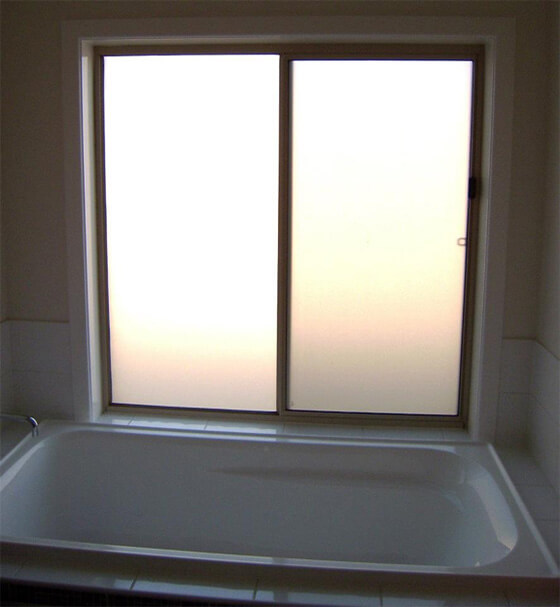 Window above bath tub with plain frosted window film applied