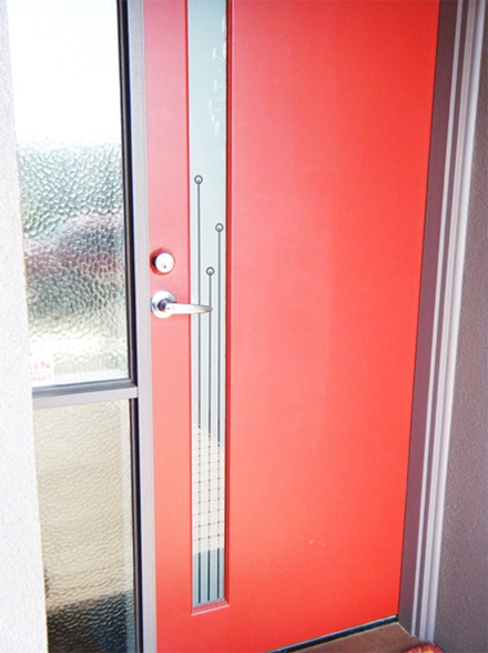 Red door with DIY frosted glass film applied