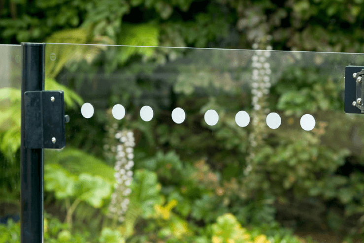 Close up of decorative frosted window decal dots